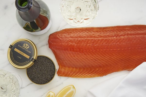 caviar with bottle of wine and salmon top view